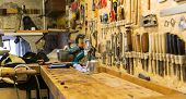 carpentry, woodwork and equipment concept - work tools and workbench at workshop poster