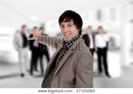 Young businessman pointing at his business team at the office