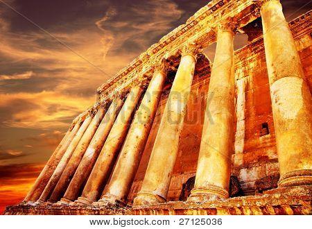 Jupiter's temple ancient Roman columns over sunset, Baalbek, Lebanon