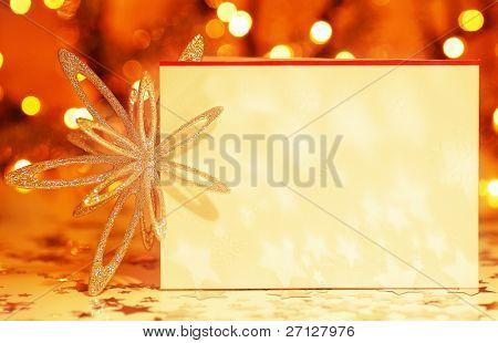 Beautiful gold happy Christmas card,winter holiday background, decoration postcard with snowflakes abstract over blur bokeh lights