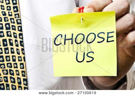 Choose us post it in business man hand