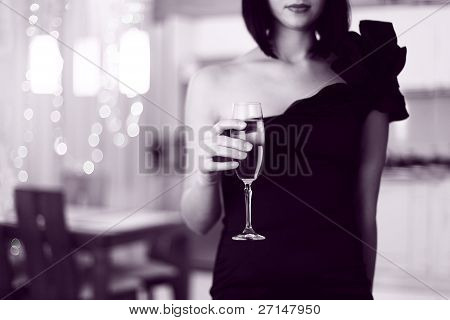 Pretty  Woman In Glad Rags,  Holding A Glass Of Champagne. Interior Background