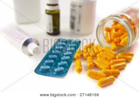 pills assortment on white bakcground