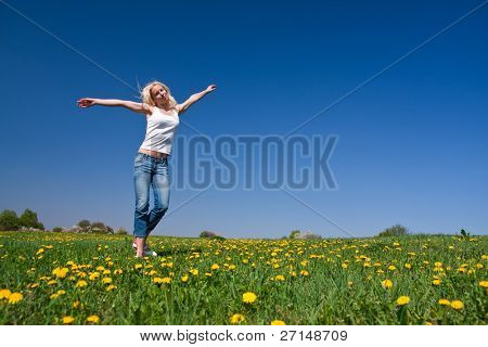 young Female having Fun on blumige Wiese