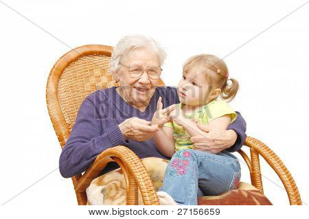 grandmother and the grand daughter in an armchair
