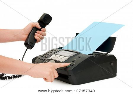 The hand presses the fax button
