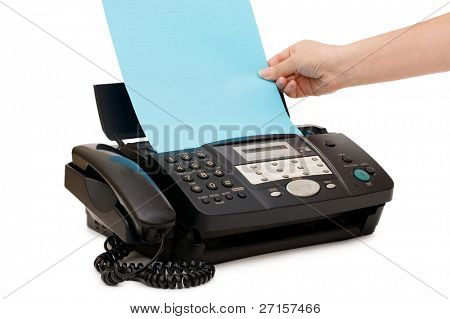 hand inserts a paper into a fax