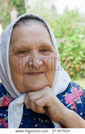 Portrait of the old woman in a scarf