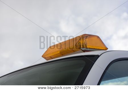 Amber Warning Revolving Lights On A Roof Of Service Vehicle