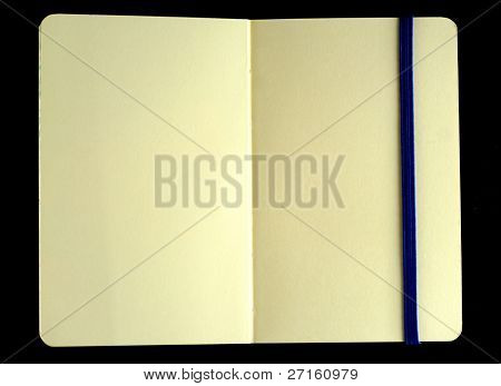 Classic opened moleskine note book with bookmark isolated on black background