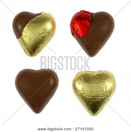 Wrapped and unwrapped chocolate hearts isolated on white