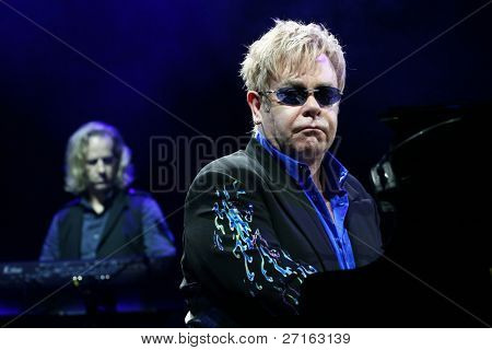MINSK, BELARUS - JUNE 26: Singer Elton John performs onstage at Minsk Arena June 26, 2010 in Minsk, Belarus