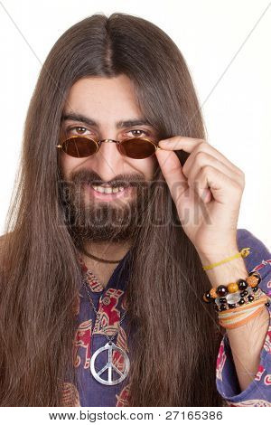 Smiling long-haired hippie man in a glasses