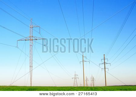 Row of power lines against a blue sky.