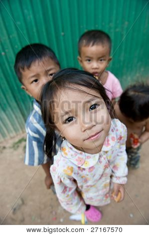 PHNOM PHEN, CAMBODIA - CIRCA JANUARY 2009: Young street children posing in Phnom Phen, Cambodia CIRCA JANUARY 2009. With widespread poverty, Cambodian street children are not a rare sight.
