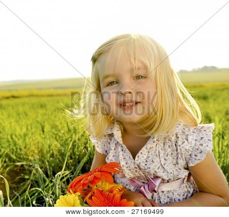 Young girl is happy outside, lens flare from the sun behind her head