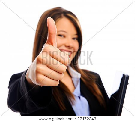 Businesswoman holding a laptop showing a thumbs up sign, selective focus on hand