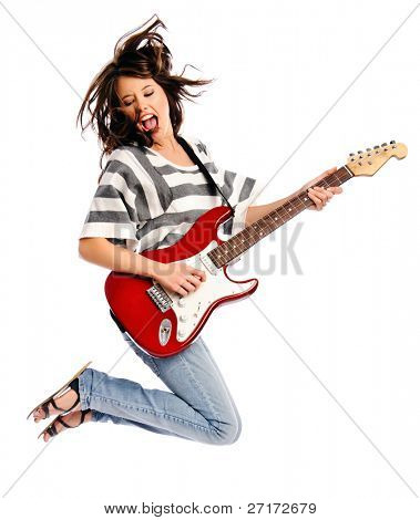 Pretty young woman rocking out with a guitar