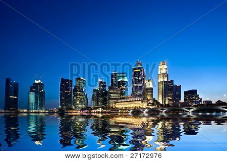 Singapore city at sunset with water reflection