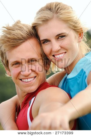 beautiful couple posing together for a happy portrait outdoors together