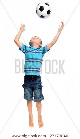 Cute boy throws and  jumps with a football in studio, isolated on white