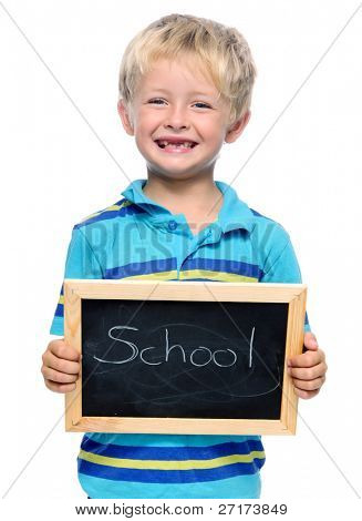 Preschool child holds a blackboard with the word school