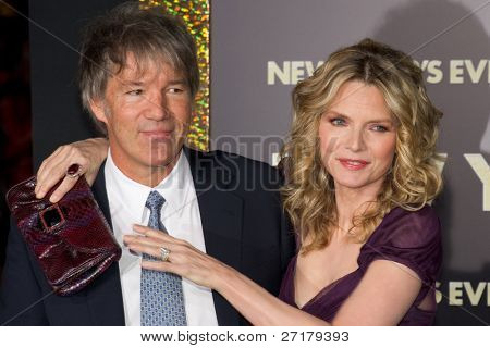 HOLLYWOOD, CA - DECEMBER 5: Actress Michelle Pfeiffer and writer David E. Kelley arrive at the premiere of