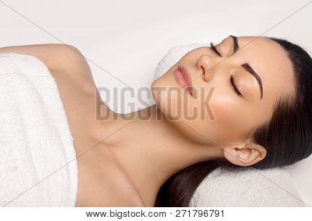 poster of Portrait Of Young Beautiful Woman In Spa Salon.spa Body Massage Treatment And Skincare.leisure. Face
