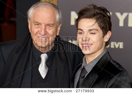 HOLLYWOOD, CA - DECEMBER 5: Director Garry Marshall and actor Jake T. Austin arrive at the premiere of