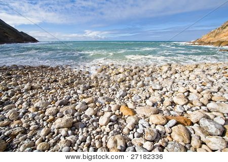 Stony beach in Espichel Cape, Portugal