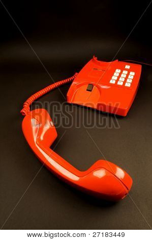 red telephone isolated on black