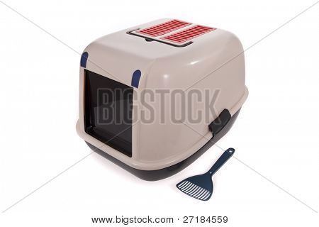 Closed cat litter box with scoop isolated on white background