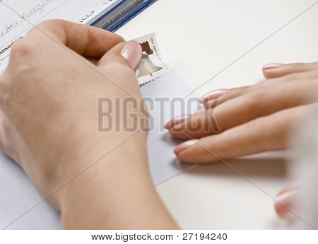 Woman addressing envelope