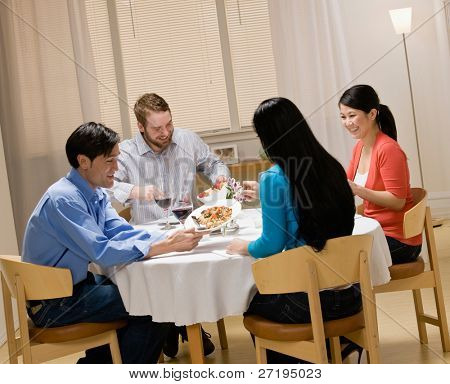 Couples enjoying meal at elegant dinner party