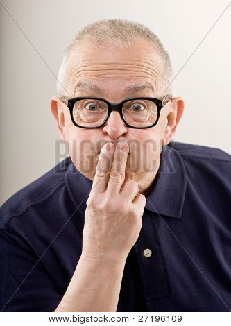 Shocked man covering mouth to keep a secret