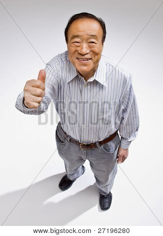 Confident man giving thumbs up gesture enthusiastically