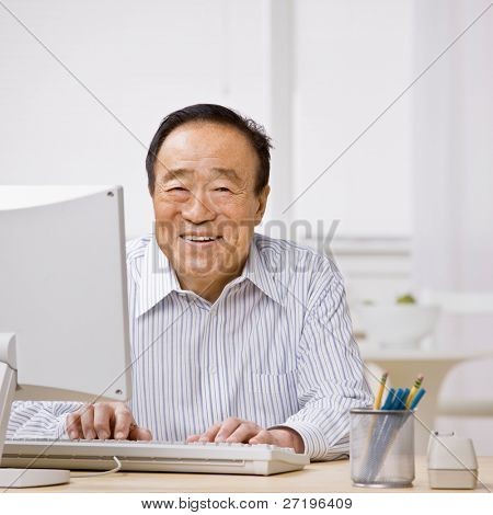 Confident man typing on computer