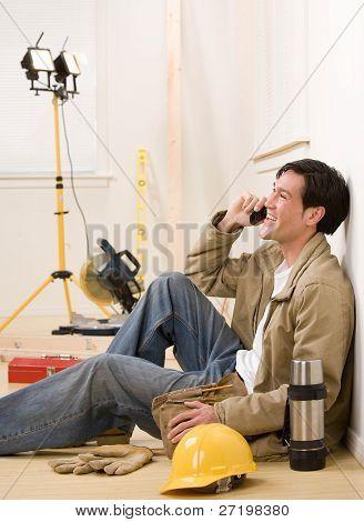 Construction worker talking on celluar phone
