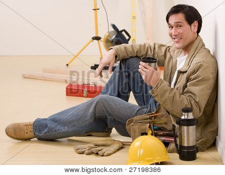 Construction worker taking a coffee break