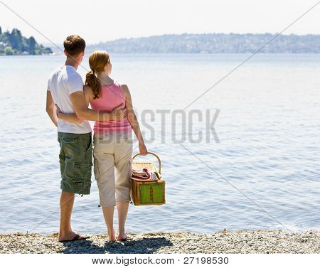 Couple having picnic near stream