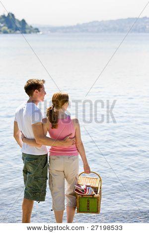 Couple having picnic near stream