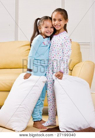 Girls in pajamas in livingroom