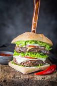Hamburger With Beef Meat Burger And Fresh Vegetables On Dark Background. Tasty Fast Food. poster