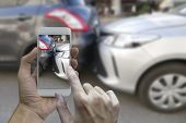 Close Up Hand Holding Smartphone And Take Photo At The Scene Of A Car Crash And Accident, Car Accide poster