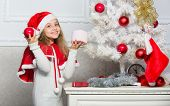 Child Decorating Christmas Tree With Red Balls Ornaments. Cherished Holiday Activity. Kid In Santa H poster