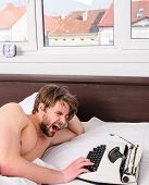 Why Author Use Manual Typewriter Daily Work. Man Writer Lay Bed White Bedclothes Working On New Book poster