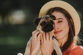 Young Dogs Owner Is Gently Hugging Her Pet poster