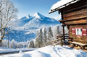 Beautiful View Of Traditional Wooden Mountain Cabin In Scenic Winter Wonderland Mountain Scenery In  poster