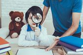 Man Spends Time With His Son. Father Is Engaged In Raising Child. Father Pointing On Homework To Son poster