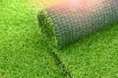Artificial Turf Laying Background. Roll Of An Synthenic Grass Layer. Greenering Of The Yard With An  poster